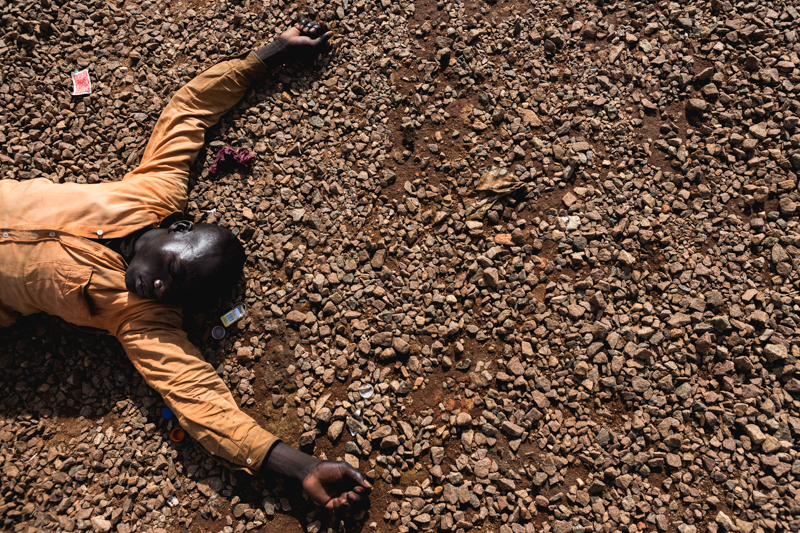 boy lying on the floor from project children of god