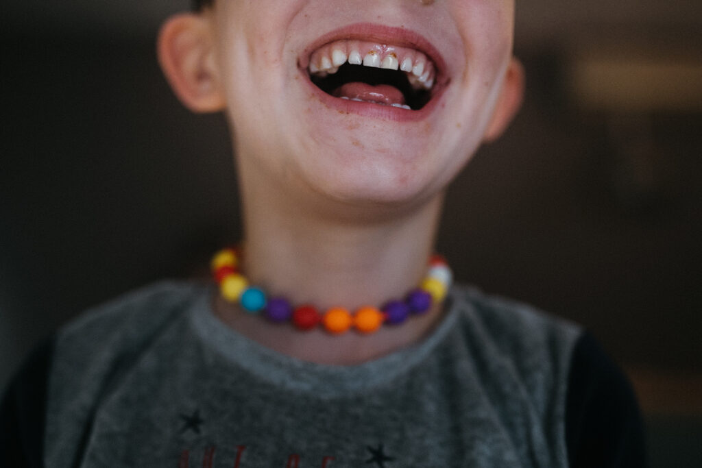 Smiling boy during the family reportage in Barcelona